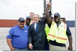 President George W. Bush joins port workers for a photo following his remarks on U.S. trade policy Tuesday, March 18, 2008, at the Blount Island Marine Terminal in Jacksonville, Fla. White House photo by Chris Greenberg