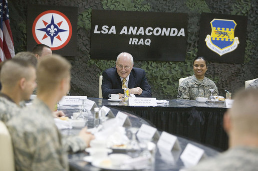 Vice President Dick Cheney talks with U.S. troops during breakfast Tuesday, March 18, 2008, at Balad Air Base, Iraq. Following a day of meetings in Baghdad the Vice President and Mrs. Cheney were overnight guests at the base. White House photo by David Bohrer