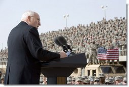 "Vice President Dick Cheney delivers remarks Tuesday, March 18, 2008 to U.S. troops during a rally at Balad Air Base, Iraq. ""During this deployment, ladies and gentlemen, you've seen incredible progress on the ground in Iraq -- not just as witnesses, but as participants,"" said the Vice President, adding, ""The President and I, and your fellow citizens, want nothing more than have you and all of your comrades return home safely at the end of this tour of duty. We're going to do everything we can to make that happen."" White House photo by David Bohrer"