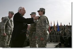 "Vice President Dick Cheney awards PFC Veronica Alfaro with the Bronze Star Tuesday, March 18, 2008, during a rally for U.S. troops at Balad Air Base, Iraq. ""I can't describe the feeling I had when he awarded me the Bronze Star,"" said Alfaro, 2nd Platoon senior medic, Bravo Company. ""It is definitely a moment I will always remember and cherish; I will never forget it.""  White House photo by David Bohrer"