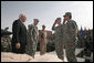 Staff Sgt. Shane Lindsey, second right, and PFC Veronica Alfaro, far right, salute Vice President Dick Cheney after being awarded the Bronze Star Tuesday, March 18, 2008, during a rally for U.S. troops at Balad Air Base, Iraq. White House photo by David Bohrer