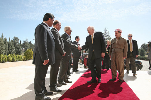 Vice President Dick Cheney greets Iraqi Kurdish officials Tuesday, March 18, 2008 upon arrival to the residence of the president of the Kurdish Regional Government in Irbil, Iraq. White House photo by David Bohrer