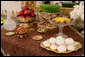 A traditional Haft Sin table celebrating Nowruz, the Persian New Year, is seen set Wednesday, March 19, 2008, in the State Dining Room of the White House. Nowruz is, in Persian and some other cultures, including Kurdish culture, a family-oriented holiday celebrating the New Year and the coming of spring. The Haft Sin table has seven items symbolizing new life, joy, love, beauty and health, sunrise, patience and garlic to ward off evil. White House photo by Chris Greenberg