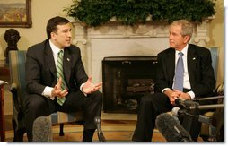"President George W. Bush listens as Mikhail Saakashvili offers remarks as they meet Wednesday, March 19, 2008, in the Oval Office of the White House. President Saakashvili expressed his gratitude for America's support, saying, ""I have to thank you, Mr. President, for your unwavering support for our freedom, for our democracy, for our territorial sovereignty, and for protecting Georgia's borders, and for Georgia's NATO aspiration.""  White House photo by Joyce N. Boghosian"