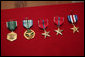 "Five U.S. service medals presented by Vice President Dick Cheney are seen displayed Thursday, March 20, 2008 during Vice President Cheney's visit to Bagram Air Base. ""We know the work is hard, we know the conditions are tough, we know the deployments are hard on families,"" said the Vice President to U.S. troops, adding, ""But we're impressed beyond measure by all of the accomplishments that you've made."" From left, the U.S. Army Commendation Medal, the Joint Service Commendation Medal, two Bronze Star Medals and a Silver Star Medal. White House photo by David Bohrer"