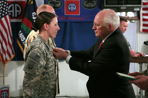 Vice President Dick Cheney awards the Silver Star Medal to Army Specialist Monica Brown of Lake Jackson, Texas Thursday, March 20, 2008, following a dinner with U.S. troops at Bagram Air Base, Afghanistan. While serving as a combat medic in April of 2007, Spc. Brown, 19, showed extraordinary heroism when she used her body to shield wounded soldiers from enemy gunfire and mortar shelling, then moving them to safety after their convoy came under attack in Afghanistan's eastern Paktia province. She is the second woman since World War II to receive the Silver Star. White House photo by David Bohrer