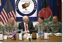 Vice President Dick Cheney shares a light moment with 19-year-old Silver Star Medal recipient U.S. Army Specialist Monica Brown, center right, during a dinner with U.S. troops Thursday, March 20, 2008 at Bagram Air Base, Afghanistan. Joining the Vice President and Spc. Brown are from left: TSgt. Vernon Jones; Army Commendation Medal for Valor recipient Spc. Charles Bell; and Spc. Brown's brother, infantryman Justin Brown. White House photo by David Bohrer