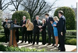 President George W. Bush thanks the council members from the President's Council on Physical Fitness and Sports following his announcement of the National President's Challenge Thursday, March 20, 2008 in the East Garden at the White House. The National President's Challenge is a six-week physical activity challenge beginning March 20th designed to get America up and moving 30 minutes a day, five days a week. White House photo by Chris Greenberg