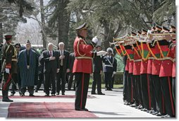 Vice President Dick Cheney is joined by President Hamid Karzai of Afghanistan for the playing of the national anthem of the United States Thursday, March 20, 2008, during an arrival ceremony at Gul Khana Palace in Kabul. While in Afghanistan the Vice President held meetings with President Karzai and visited Bagram Air Base for a classified briefing and dinner with U.S. troops. White House photo by David Bohrer