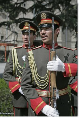 Members of an Afghanistan military honor guard sing their national anthem Thursday, March 20, 2008 during a ceremony in honor of the arrival of Vice President Dick Cheney. The Vice President's visit to Kabul comes at a critical time as allied members of NATO consider their future commitments to the young democracy's development. White House photo by David Bohrer