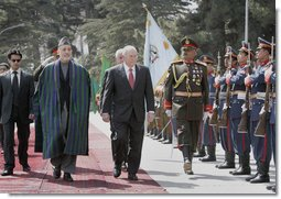 Vice President Dick Cheney, accompanied by President Hamid Karzai of Afghanistan, reviews an honor guard upon his arrival to Kabul Thursday, March 20, 2008. The Vice President's visit to Afghanistan is the third stop on a 10-day trip to the Middle East and Turkey. White House photo by David Bohrer