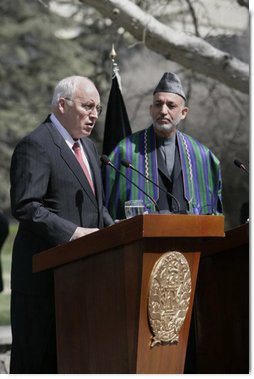 "With President Hamid Karzai of Afghanistan looking on, Vice President Dick Cheney delivers a statement to the press Thursday, March 20, 2008 on the grounds of Gul Khana Palace in Kabul. ""During the last six years, the people of Afghanistan have made a bold and confident journey, throwing off the burden of tyranny, winning your freedom and reclaiming your future,"" said the Vice President, adding, ""The United States of America has proudly walked with you on this journey, and we walk with you still.""  White House photo by David Bohrer"