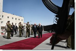 Vice President Dick Cheney and President Mahmoud Abbas of the Palestinian Authority walk through an honor cordon after the arrival Sunday, March 23, 2008, of the vice president to the West Bank city of Ramallah. White House photo by David Bohrer