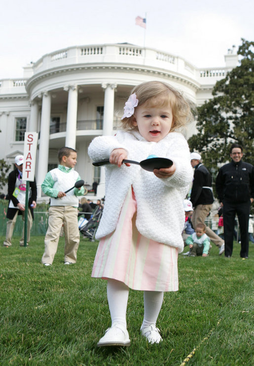 A young child carefully balances her Easter Egg on a spoon Monday, March 24, 2008 on the South Lawn of the White House, during the 2008 White House Easter Egg Roll. White House photo by Joyce N. Boghosian