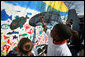 Kids paint a large mural of an ocean scene at the White House Easter Egg Roll Monday, Mar. 24, 2008 on the South Lawn of the White House. The theme for the 2008 Easter Egg Roll is Ocean Conservation. The kids were able to learn how to keep our oceans clean and healthy for fish and other ocean life. White House photo by Joyce N. Boghosian
