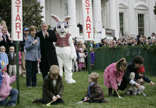 President George W. Bush, joined by Mrs. Laura Bush, blows a whistle Monday, March 24, 2008 on the South Lawn of the White House, to officially start the festivities for the 2008 White House Easter Egg Roll. White House photo by Shealah Craighead