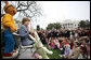 "Mrs. Laura Bush, joined by her daughter, Jenna, and the PBS character ""Arthur,"" reads the book ""Arthur Meets the President,"" Monday, March 24, 2008, during festivities at the 2008 White House Easter Egg Roll on the South Lawn of the White House. White House photo by Shealah Craighead"