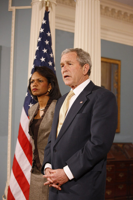 President George W. Bush stands with U.S. Secretary of State Condoleezza Rice as he talks with reporters Monday, March 24, 2008, following a briefing at the U.S. Department of State in Washington, D.C. White House photo by Eric Draper