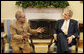 President George W. Bush welcomes India's Minister of External Affairs Pranab Kumar Mukherjee to a meeting in the Oval Office Monday, March 24, 2008, at the White House. White House photo by Eric Draper