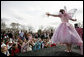 Children gather at the Magic Stage on the South Lawn of the White House to watch magician Fairy Twinkletoes perform Monday, March 24, 2008, during the 2008 White House Easter Egg Roll. White House photo by Grant Miller