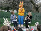 "Mrs. Laura Bush, joined by her daughter, Jenna, applauds the PBS character ""Arthur,"" following the reading of ""Arthur Meets the President,"" Monday, March 24, 2008, during festivities at the 2008 White House Easter Egg Roll on the South Lawn of the White House. White House photo by Patrick Tierney"