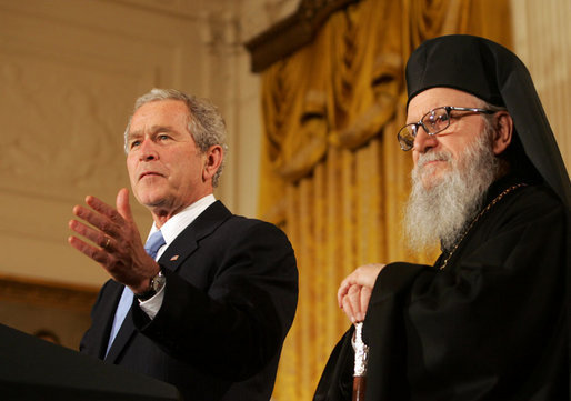 President George W. Bush is joined by Archbishop Demetrios as he delivers his remarks at the Celebration of Greek Independence Day Tuesday, March 25, 2008, in the East Room of the White House. White House photo by Joyce N. Boghosian