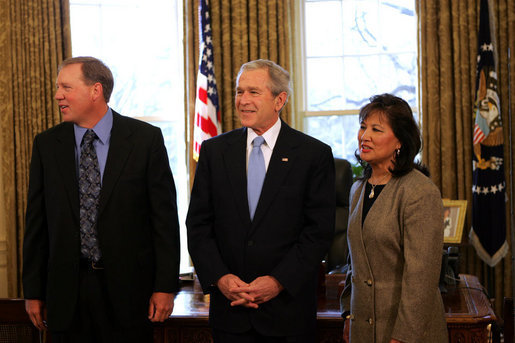 President George W. Bush speaks to reporters with Alton Jones, 2008 Bassmaster Classic Champion, and Judy Wong, 2008 Women's Bassmaster Tour Champion Tuesday, Mar. 25, 2008, in the Oval Office at the White House. White House photo by Joyce N. Boghosian