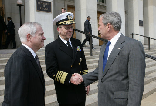 President George W. Bush shakes hands with Joint Chiefs of Staff Chairman Admiral Michael Mullen, and accompanied by U.S. Defense Secretary Robert Gates, as he departs the Pentagon Wednesday, March 26, 2008, following a briefing at the U.S. Department of Defense in Arlington, Va. White House photo by Chris Greenberg