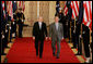 President George W. Bush and Australian Prime Minister Kevin Rudd walk together through Cross Hall to the East Room of the White House Friday, March 28, 2008, for their joint press availability. White House photo by Joyce N. Boghosian
