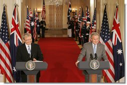 President George W. Bush and Australian Prime Minister Kevin Rudd react to a question during their joint press availability in the East Room of the White House Friday, March 28, 2008. White House photo by Joyce N. Boghosian