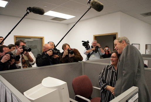 President George W. Bush greets employees prior to making remarks Friday, March 28, 2008, at Novadebt in Freehold, New Jersey. White House photo by Chris Greenberg