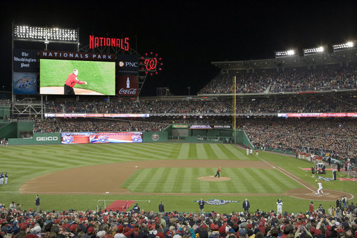 President George W. Bush throws the ceremonial first pitch before a sold out crowd at the Washington Nationals season opener, as they host the Atlanta Braves Sunday, March 30, 2008, at their new home field at Nationals Park in Washington, D.C. White House photo by Chris Greenberg
