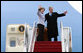 President George W. Bush and Mrs. Laura Bush wave as they board Air Force One Monday, March 31, 2008, for departure to Kyiv, Ukraine, the first stop on their European visit that will include the NATO Summit in Bucharest. White House photo by Chris Greenberg