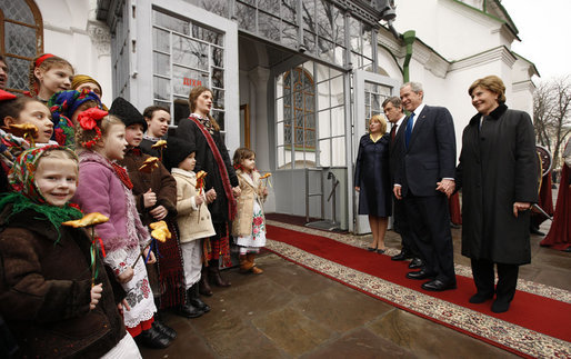 President George W. Bush and Mrs. Laura Bush joined by Ukrainian President Viktor Yushchenko and his wife, first lady Kateryna Yushchenko, are greeted by children, April 1, 2008, before touring St. Sophia's Cathedral in Kyiv, Ukraine. White House photo by Eric Draper