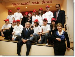 President George W. Bush and Mrs. Laura Bush pose with students from School 57 in Kyiv Tuesday, April 1, 2008, after the Ukrainian teens performed a skit sponsored by PEPFAR, the President's Emergency Plan for AIDS Relief.  White House photo by Shealah Craighead
