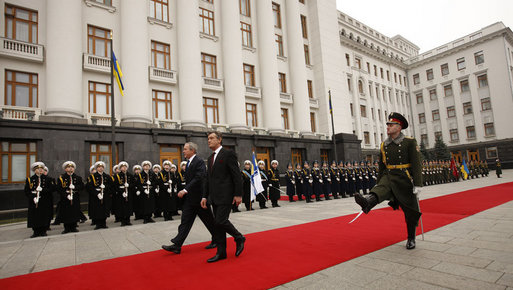 President George W. Bush and President Viktor Yushchenko review the troops during arrival ceremonies Tuesday, April 1, 2008, at the Presidential Secretariat in Kyiv. White House photo by Eric Draper