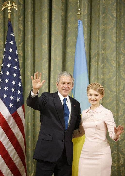 President George W. Bush and Ukraine Prime Minister Yuliya Tymoshenko wave to the media following their meeting Tuesday, April 1, 2008, at Kyiv's Club of Cabinet Ministers. White House photo by Eric Draper
