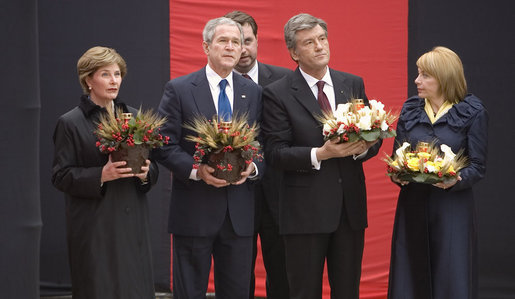 Carrying bowls of corn with candles, President George W. Bush and Mrs. Laura Bush and Ukraine President Viktor Yushchenko and Mrs. Kateryna Yushchenko visit the Holomodor Memorial in Kyiv Tuesday, April 1, 2008. The memorial honors victims of Ukraine's great famine of 1932. White House photo by Eric Draper