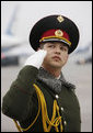 A member of the honor guard salutes as President George W. Bush and Mrs. Laura Bush prepare to depart Kyiv's Boryspil State International Airport Tuesday, April 1, 2008, after spending a daylong visit in Ukraine before continuing on to Bucharest, site of the 2008 NATO Summit. White House photo by Eric Draper