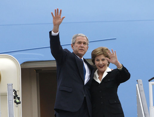 President George W. Bush and Mrs. Laura Bush wave upon their Romanian arrival Tuesday, April 1, 2008, at Henri Coanda International Airport in Bucharest, site of the 2008 NATO Summit. White House photo by Eric Draper