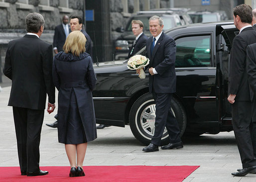 President George W. Bush carries a bouquet of flowers on his arrival to meet President Viktor Yushchenko of Ukraine, and his wife, Mrs. Kateryna Yushchenko Tuesday, April 1, 2008, at the Presidential Secretariat in Kyiv for their welcoming ceremony. White House photo by Chris Greenberg