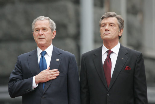 President George W. Bush stands with hand over heart during the playing of the national anthem Tuesday, April 1, 2008, during arrival ceremonies at the Presidential Secretariat in Kyiv. Standing with him is Ukrainian President Viktor Yushchenko. White House photo by Chris Greenberg