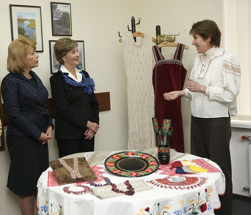 "A volunteer briefs Mrs. Laura Bush and Mrs. Kateryna Yushchenko during their visit Tuesday, April 1, 2008, to the Ukraine Peace Corps headquarters in Kyiv. Mrs. Bush thanked all the volunteers for their service, telling them that during their 27 months of service, they serve as ambassadors for the United States, ""sharing the best of our country with those who may never come into contact with another American."" White House photo by Shealah Craighead"