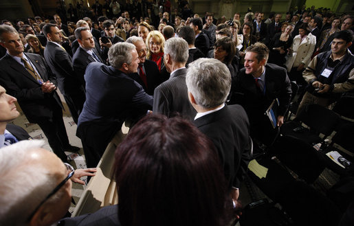 President George W. Bush reaches out to members of the audience Tuesday, April 2, 2008, after he delivered a keynote speech in Bucharest hours before the opening of the two-day NATO Summit. White House photo by Eric Draper