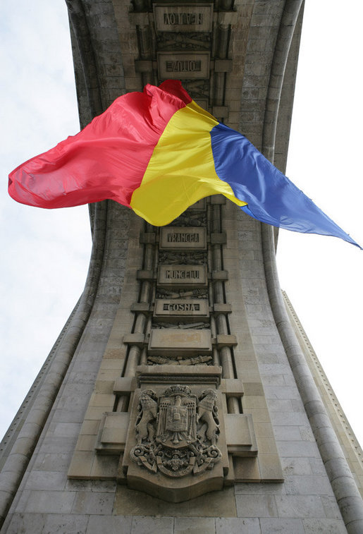 The flag of Romania hangs proudly from the Arcul de Triumf, a 27-meter high arch located in north Bucharest, site of the 2008 NATO Summit. White House photo by Chris Greenberg