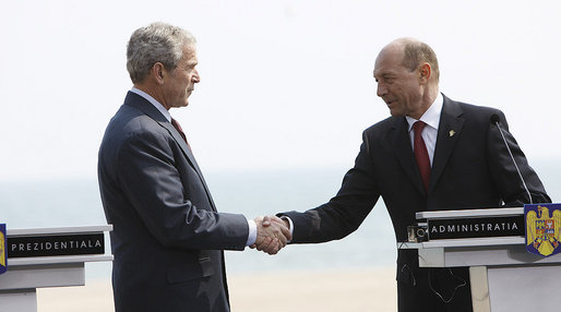 President George W. Bush and President Traian Basescu of Romania, shake hands after concluding their joint press availability Wednesday, April 2, 2008, at the presidential retreat in Neptun, Romania. White House photo by Eric Draper