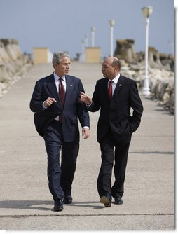 President George W. Bush and President Traian Basescu walk back from their joint press availability Wednesday on the grounds of the presidential retreat at Villas Neptun-Olimp in Neptun, Romania. White House photo by Eric Draper