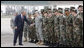 President George W. Bush reaches out to U.S. military personnel Wednesday, April 2, 2008, as he arrived at Mihail Kogalniceanu Airport in Constanta, Romania, for his return flight to Bucharest after meeting with President Traian Basescu at his presidential retreat in Neptun. White House photo by Eric Draper