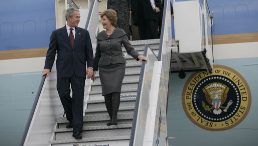 President George W. Bush and Mrs. Laura Bush steal a moment as they deplane Air Force One Wednesday, April 2, 2008, upon their return to Bucharest from the Romanian presidential retreat in Neptun, Romania. White House photo by Shealah Craighead