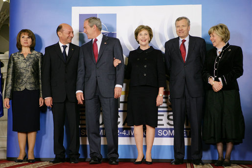 President George W. Bush and Mrs. Laura Bush share a light moment Wednesday, April 2, 2008, with Romania's President Traian Basescu and Mrs. Maria Basescu, left, and NATO Secretary General Jaap de Hoop Scheffer and Mrs. Jeannine de Hoop Scheffer during the NATO Summit official greeting at the Cotroceni Palace in Bucharest. White House photo by Chris Greenberg